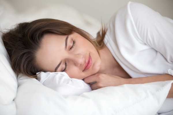 Woman sleeps peacefully without Carpal Tunnel Pain. Carpal Comfort - Designed to Soothe Carpal Tunnel Pain